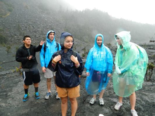 Getting drenched by the rain at Volcanoes National Park (Hawai'i) gave a lot of us a mean cold. Thank goodness for Vit C. I'm the one in the middle. Photo by Janelle Williams.