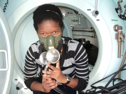 Inutti with an oxygen mask in one of the hyperbaric chambers. Image: Provided